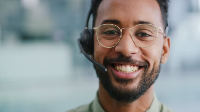 We love hearing from our clients 4k video footage of a young businessman wearing a headset in while working in a office hands free device stock videos & royalty-free footage