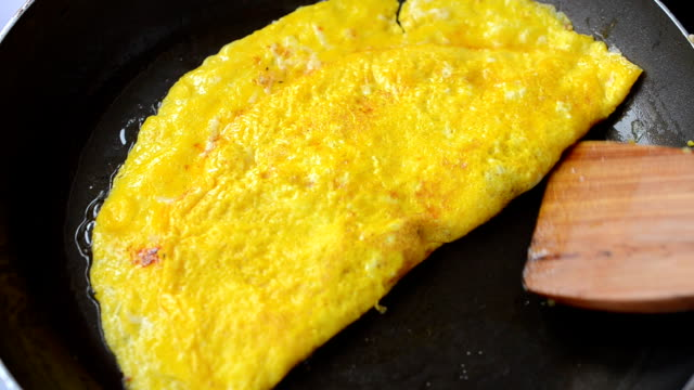 We pan fry an omelet. video