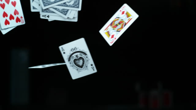 We play the cards we're dealt 4k video footage of cards falling in slow motion against a black studio background playing card stock videos & royalty-free footage