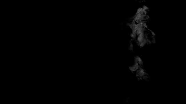 Weak and narrow Smoke or steam swirling on black background Weak and narrow Smoke or steam swirling on black background steam stock videos & royalty-free footage
