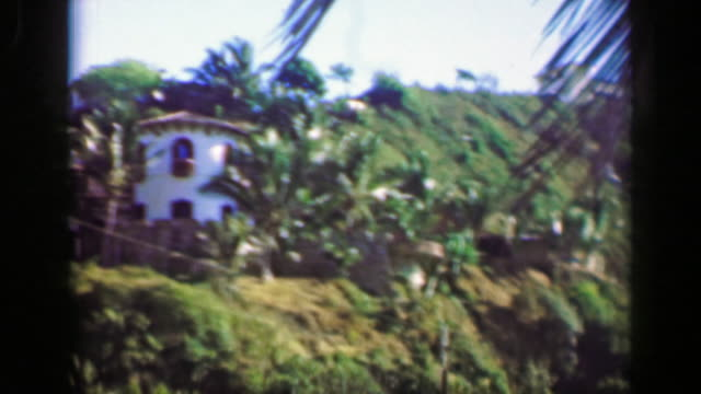1952: wealthy villa houses in tropical setting mountain cliff overlooks. - guerrero video stock e b–roll