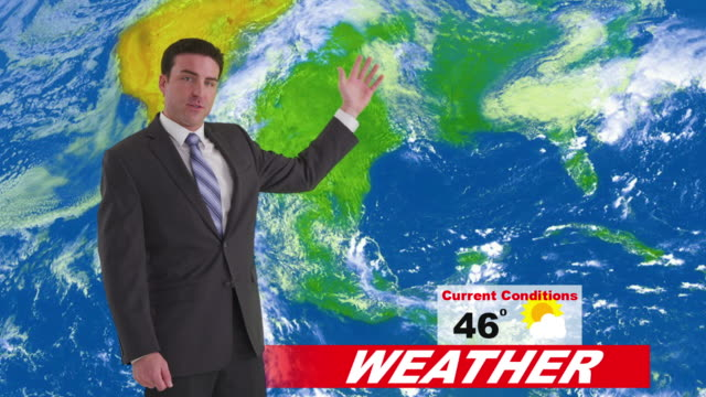 Weatherman in news studio giving weather forecast