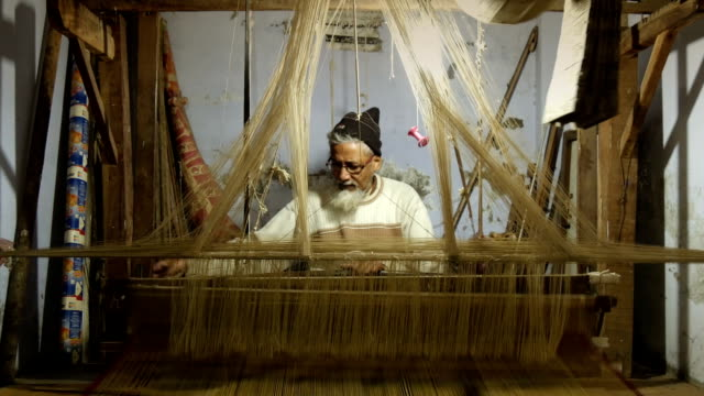 Weaver at work portrait of an asian artisan in his workplace sari stock videos & royalty-free footage
