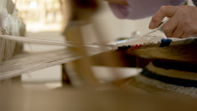 Weaver worker Weaver working on a traditional loom art and craft product stock videos & royalty-free footage
