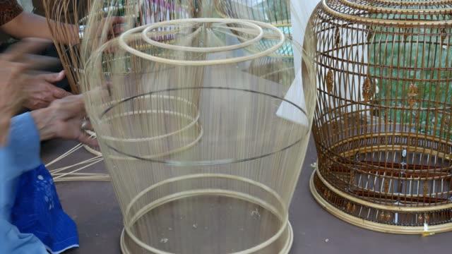 Weaving a birdcage, Thailand video