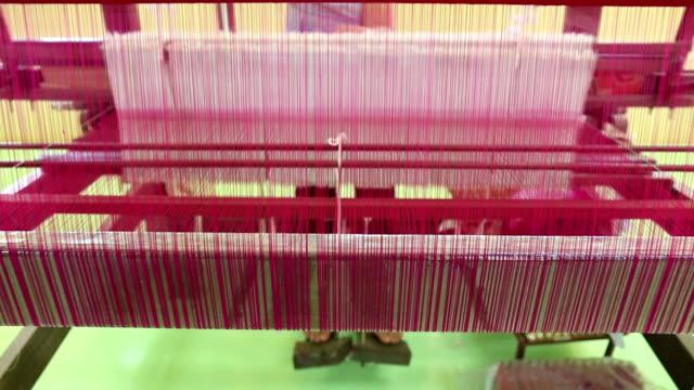 weaving brocade using a traditional loom machine with yarn video