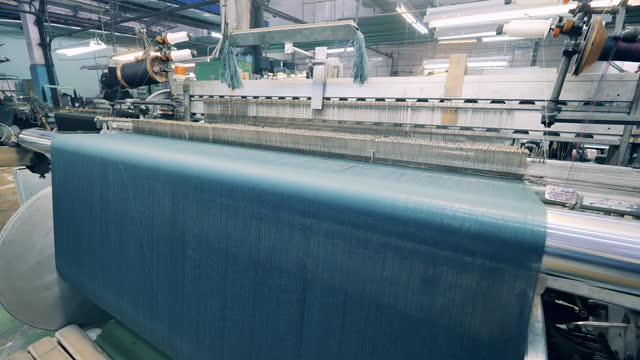 Weaving machinery complex is processing coloured threads video