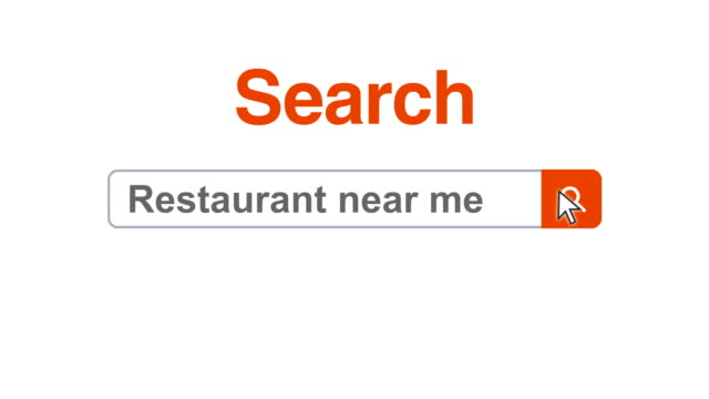 Web browser or web page with a search box typing restaurant near me for internet searching