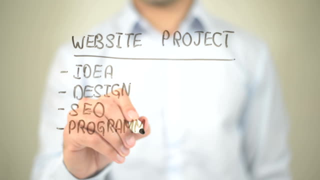 Website Project, Concept,  Man writing on transparent screen video