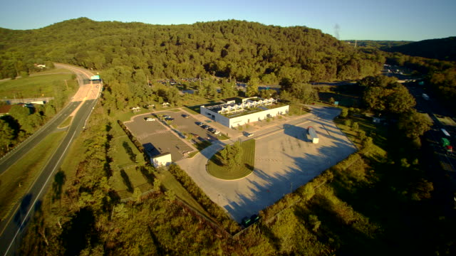 'Weclome to Pennsylvania' visitor center near be to the I-80 Columbus highway near by Delaware Water Gap, at the border between New Jersey and Pennsylvania. Aerial drone video footage. video