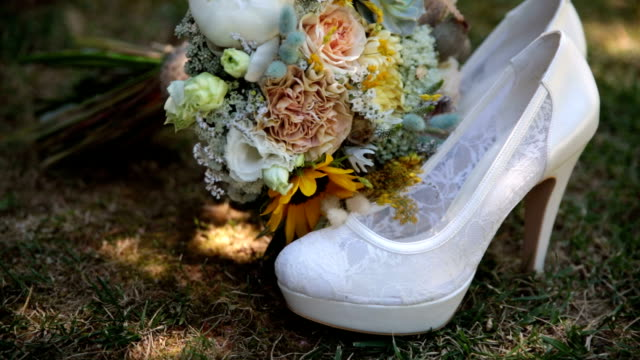 wedding bouquet and beautiful wedding shoes - country fashion stock videos & royalty-free footage