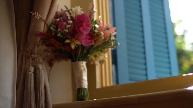 wedding bouquet close to window - bouquet video stock e b–roll