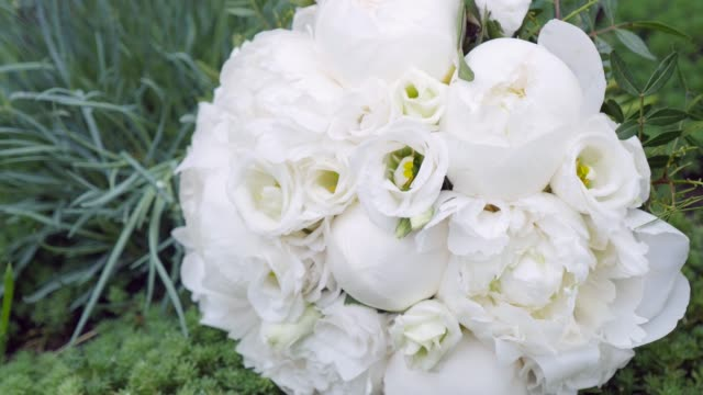 Wedding bouquet made of white roses isolated on a white background video
