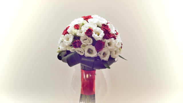 Wedding bouquet of rose bush, eustoma and greens. Bouquet in rotation