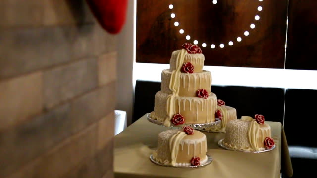 Wedding cake decorated by flowers video
