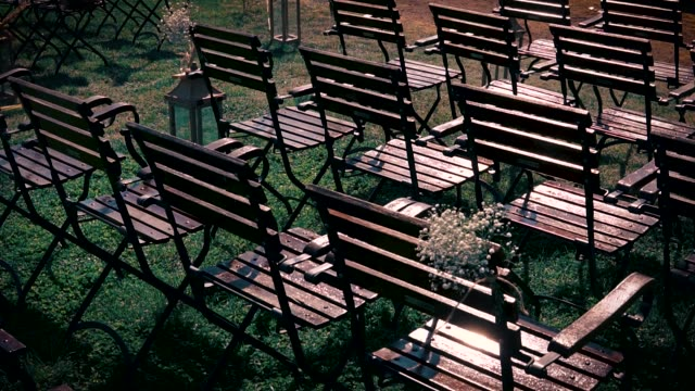 Wedding ceremony decorations. Empty chairs on a green grass. video