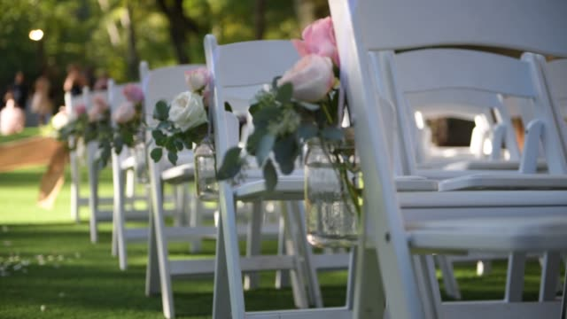 wedding ceremony on nature in green park. decorations for wedding ceremony - matrimonio video stock e b–roll
