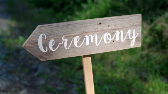 Wedding Ceremony Sign Green Forest Background Shadows Lighting video