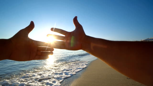 wedding couple holding hands on sunset on sea beach - young couple wedding friends video stock e b–roll