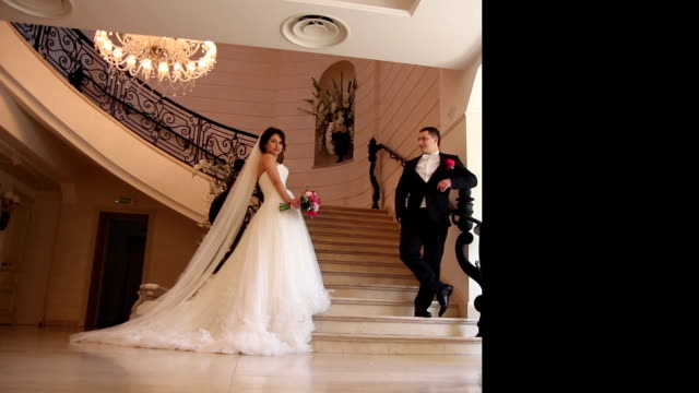 wedding couple posing near stairs. multiscreen video