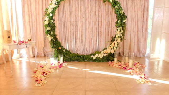 Wedding decor. Round wedding arch. Wedding decor. Beautiful composition of flowers and green leaves in wedding arch in the restaurant. Round wedding arch. tulle netting stock videos & royalty-free footage