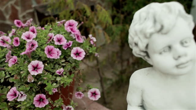 Wedding decoration of wedding ceremony. Flower and sculpture of an angel boy video