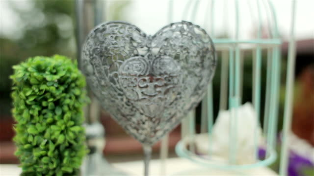 Wedding decoration of wedding ceremony. Iron heart. Camera moves away video