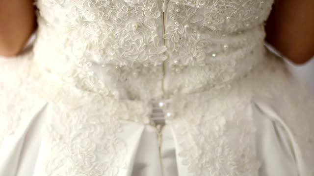vídeos y material grabado en eventos de stock de detalle del vestido de boda  - tul textil