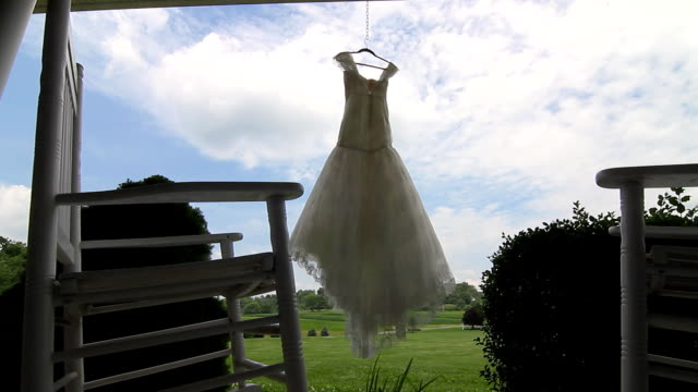 Wedding dress hanging on a porch video