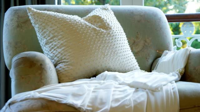 Wedding dress lying on the armchair 4K 4k Wedding dress lying on the armchair at home 4K 4k lounge chair stock videos & royalty-free footage