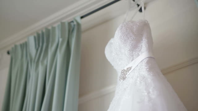 Wedding dress on hanger Wedding dress of a bride on a trample stamping feet stock videos & royalty-free footage