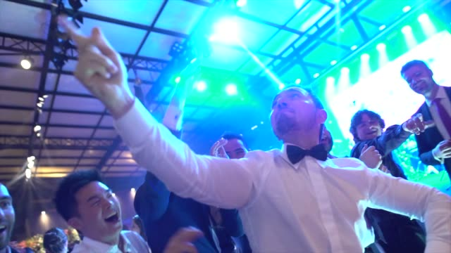 Wedding guests dancing during party Wedding guests dancing during party newlywed stock videos & royalty-free footage