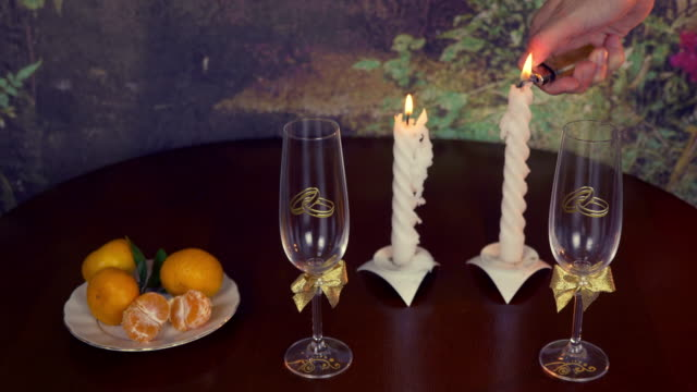 Wedding ring and glasses of champagne, and ornaments on black background. Valentine. video