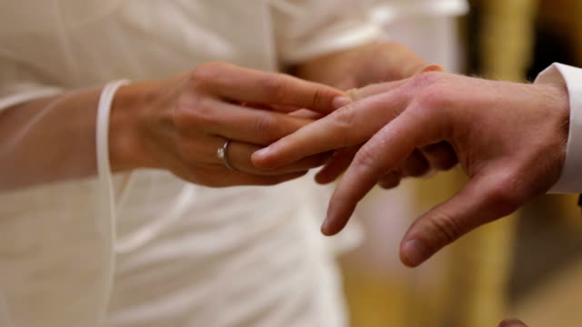 Wedding Ring is placed on Groom's finger during Vows ceremony video