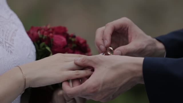 Wedding rings on the hand of young people video