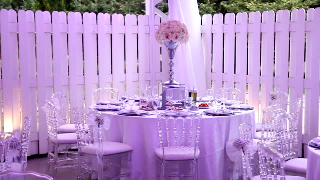 Wedding table decoration with flowers and wineglasses video