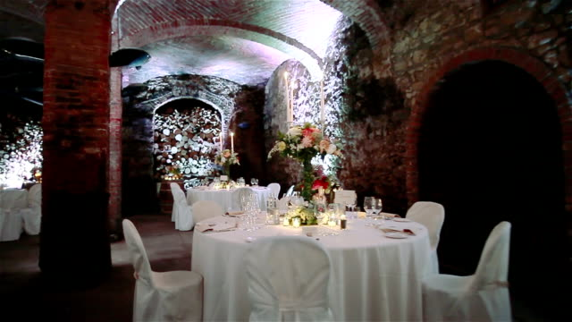 Wedding tables in wine cellar. Flycam, 2 shots in a sequence video