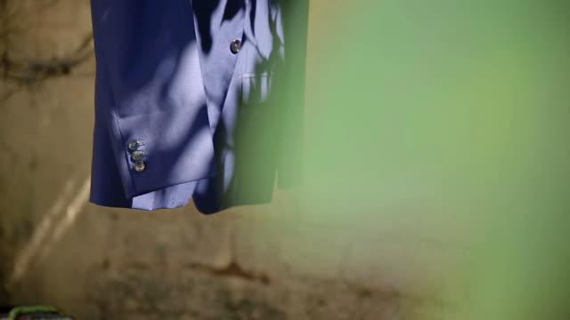 Wedding, the bridegroom's jacket is hanging in the garden video