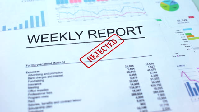 Weekly report rejected, hand stamping seal on official document, statistics