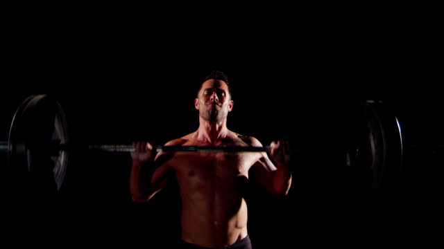 Weight lifter training at gym video