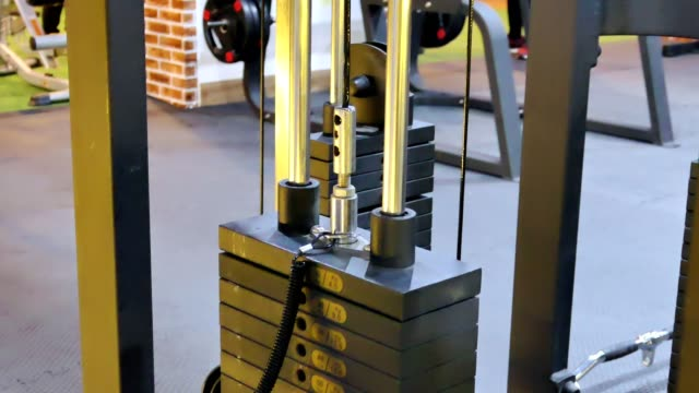 weight-lifting are strengthen the chest muscles in gym - torace umano video stock e b–roll