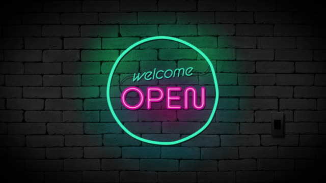 Welcome open neon sign on brick wall background. Business and service concept.