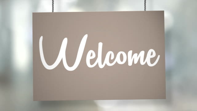 Welcome sign hanging from ropes. Luma matte included so you can put your own background. video