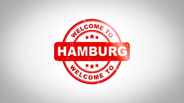 vídeos de stock e filmes b-roll de welcome to hamburg  signed stamping text wooden stamp animation. red ink on clean white paper surface background with green matte background included. - berlin wall