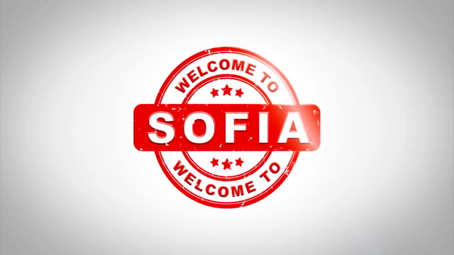 Welcome to SOFIA  Signed Stamping Text Wooden Stamp Animation. Red Ink on Clean White Paper Surface Background with Green matte Background Included.