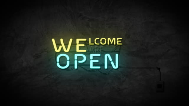 Welcome we are open neon sign on brick wall background. Business and service concept.