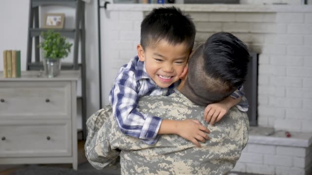 welcoming dad home - reunion stock videos & royalty-free footage