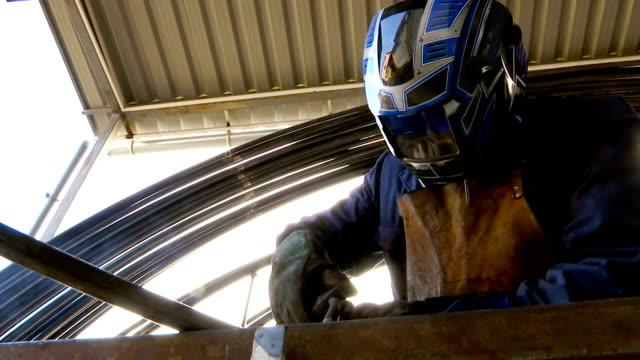 Welder carries out welding of metal video