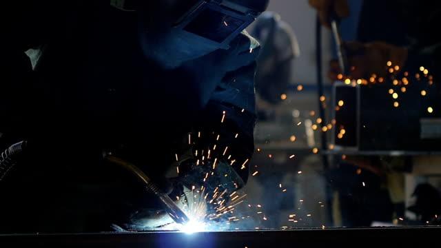Welder in Equipment Works with Welding Machine
