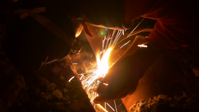 A welder welding a ruptured heating pipe at night video